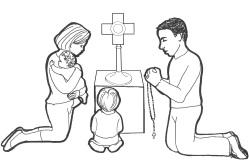 Family praying before monstrance